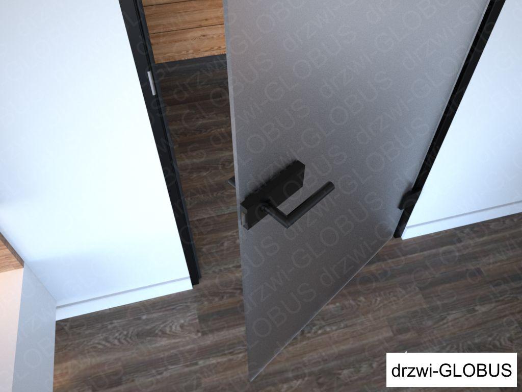 Drzwi szklane otawierane w futrynie aluminiowej czarnej, ujęcie na zamek